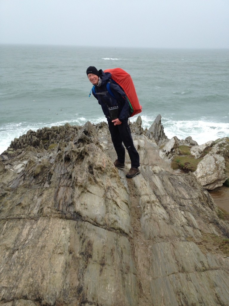 Struggling to stay upright in the gale at Morte Point